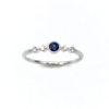 """Anillo Zafiro Azul Brillantes Anillo elaborado en oro blanco 1ª Ley 18k, 750 milésimas, zafiro azul y 4 diamantes talla brillante 0,06 ct. Es perfecto para la pedida de mano como anillo de compromiso, una novia feliz que llevará """"algo azul"""", el día de vuestra boda."""